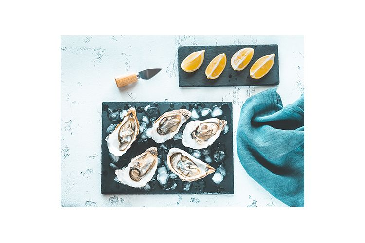 Raw oysters on the slate board example image 1