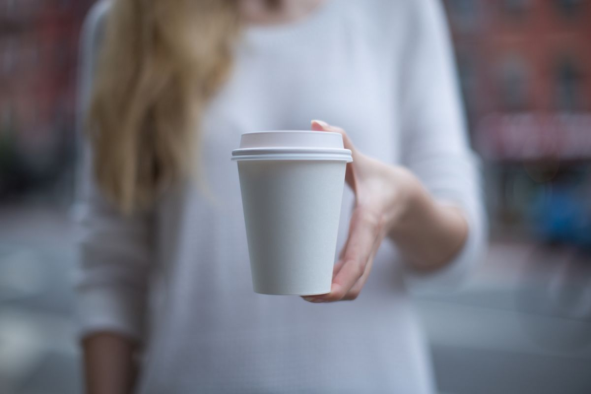 Women hand holding paper cup example image 1