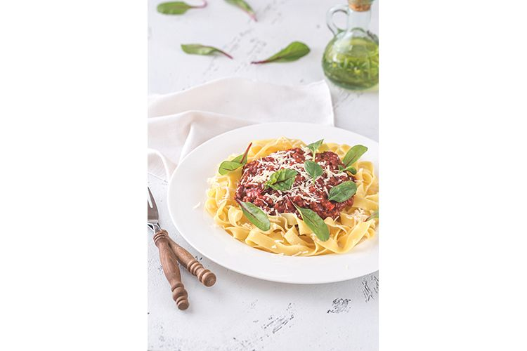 Portion of tagliatelle with bolognese sauce example image 1