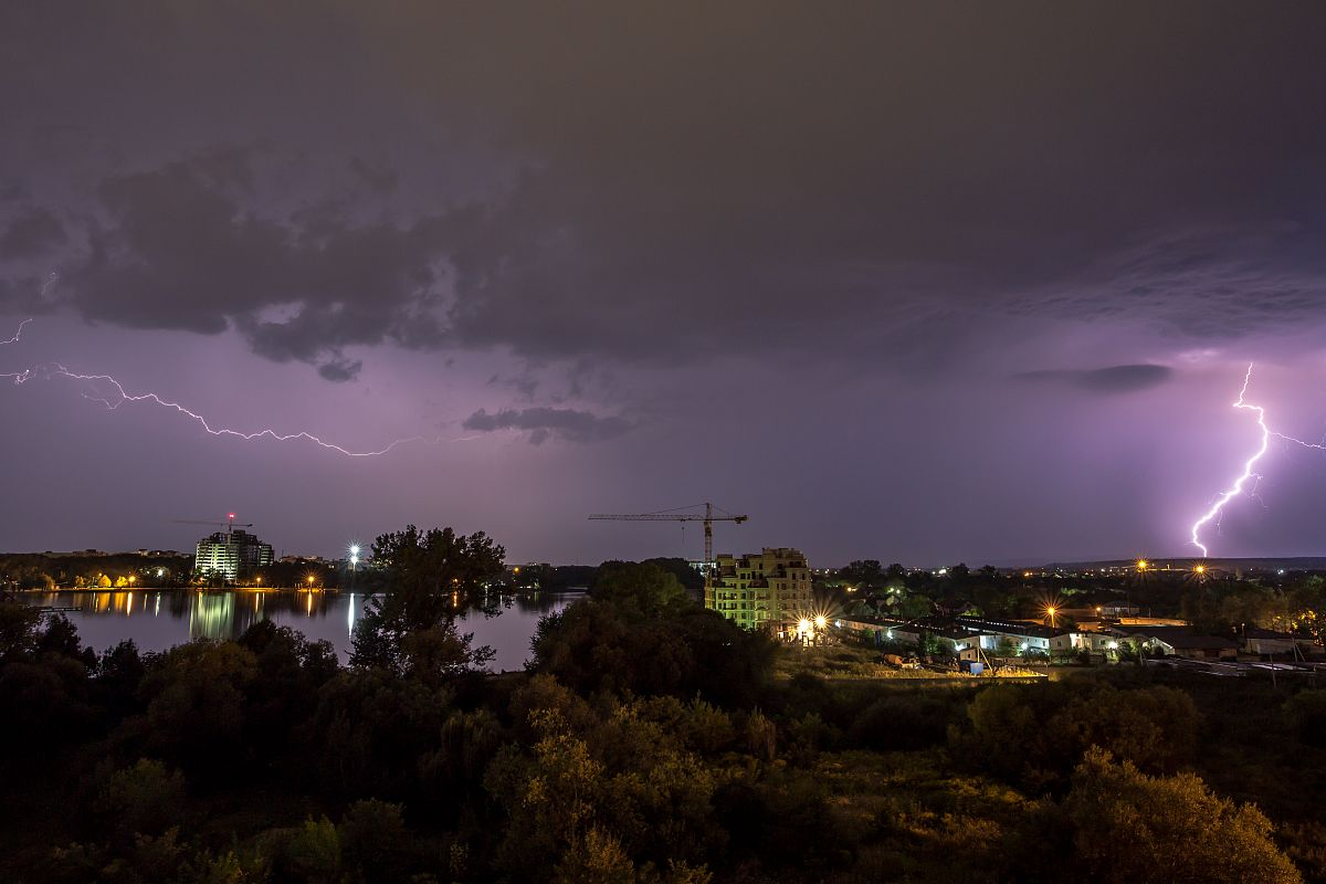 Thunder and lightning storm at night in the village example image 1