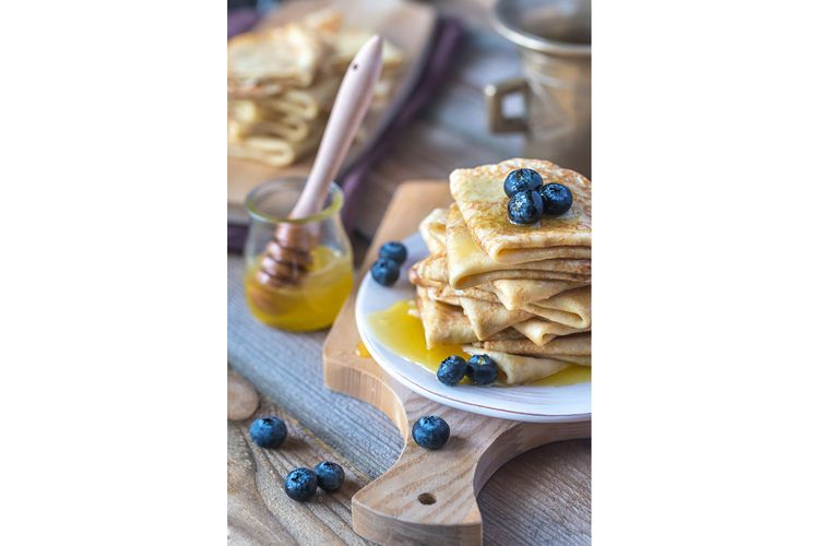Crepes with fresh blueberries and honey example image 1