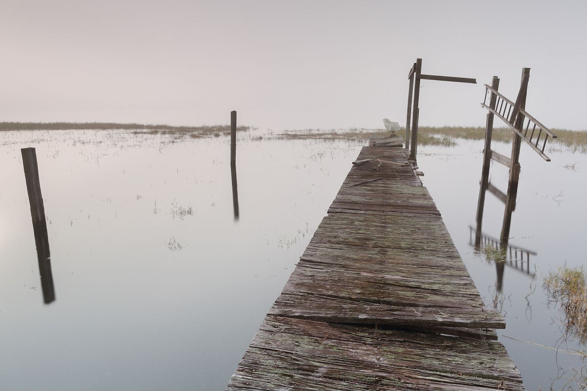 View on abandoned pier on a foggy morning example image 1