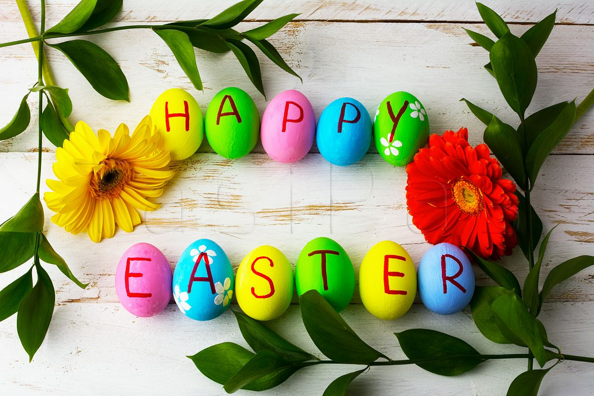 Easter eggs on a white wooden background.  example image 1