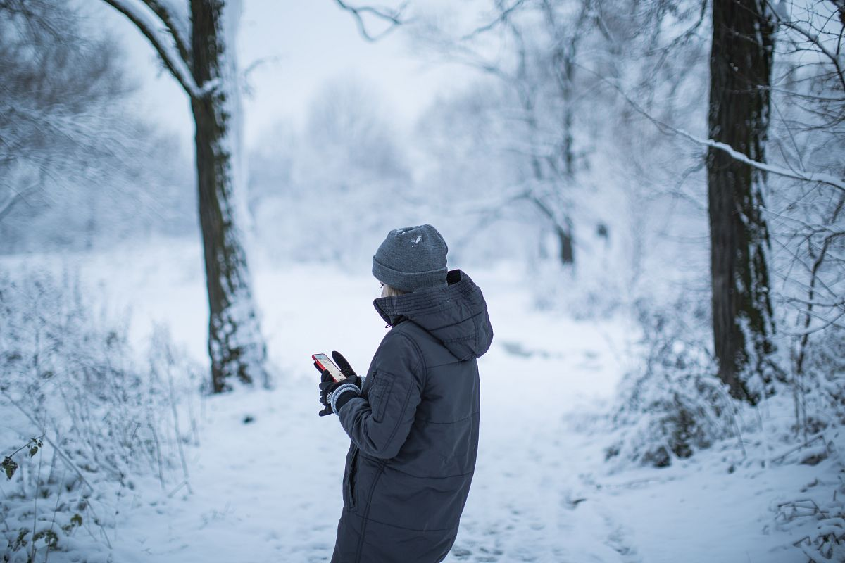 Girl taking photos in the snow forest example image 1