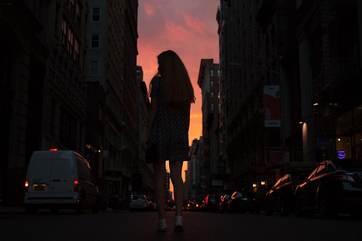 Women walking down the street during sunset example image 1