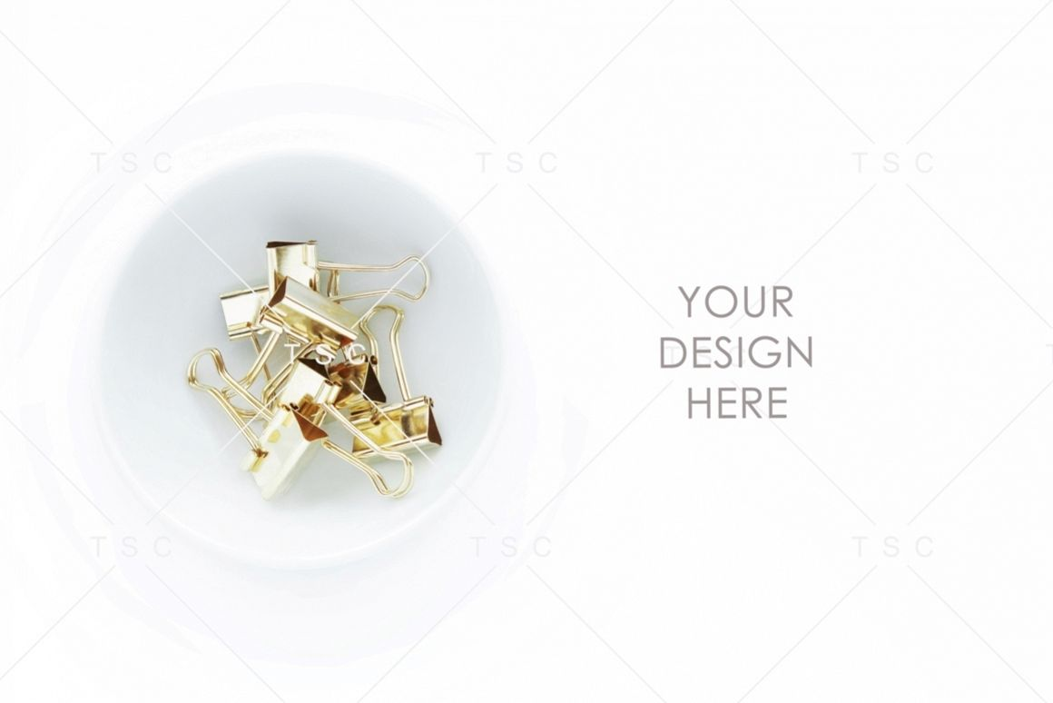 Gold Paper Clips on a White Bowl Stock Photo example image 1