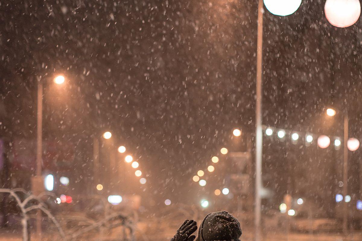 Girl enjoying snowfall night example image 1