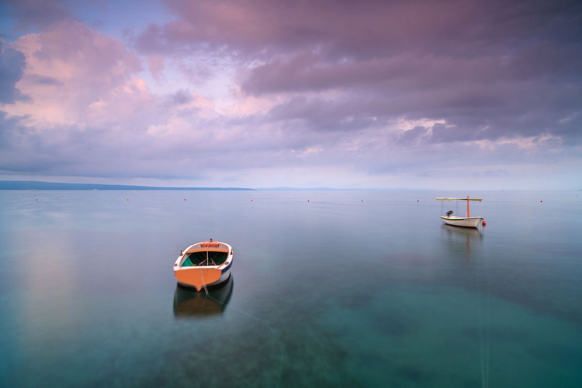 Two boats in adriatic sea at sunrise example image 1