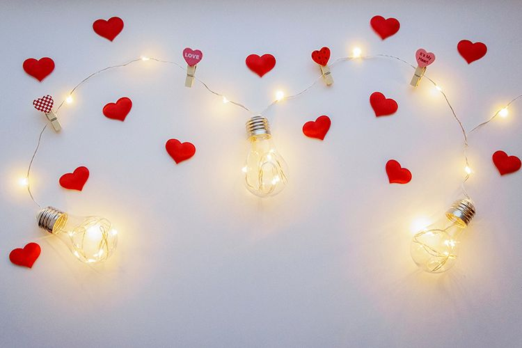 White background with lamps and small red hearts example image 1