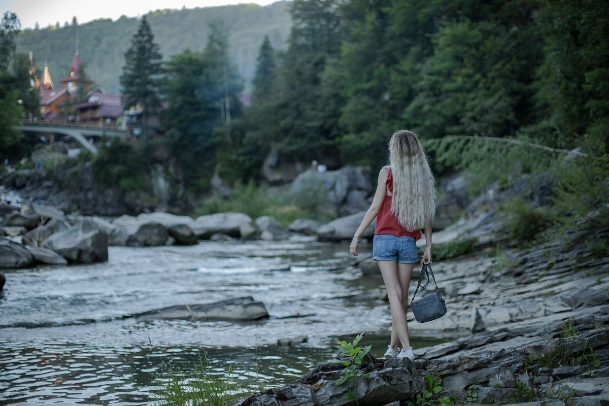 Girl at the river in the Carpathian Mountains example image 1