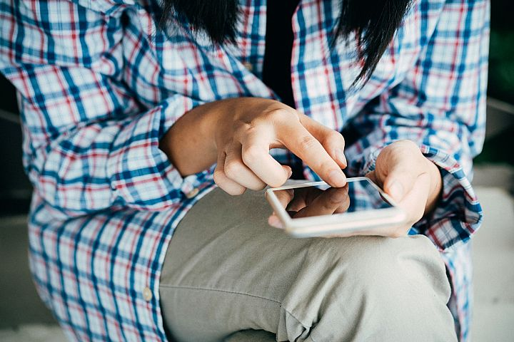 Woman using smartphone or mobile phone