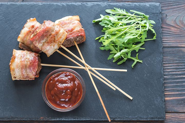 Bacon-wrapped beef skewers stuffed with mozzarella