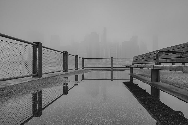 Financial district at foggy morning from the pier