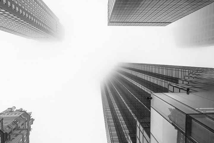 Midtown Manhattan Skyscraper covered in fog with lookup view