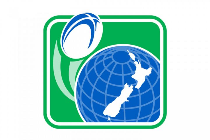 Rugby ball flying of globe with New zealand map