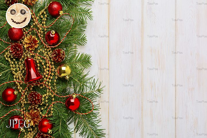 Christmas background with golden beads decorated wreath