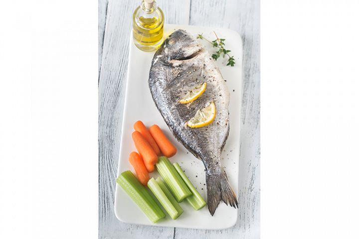 Baked dorada with fresh vegetables