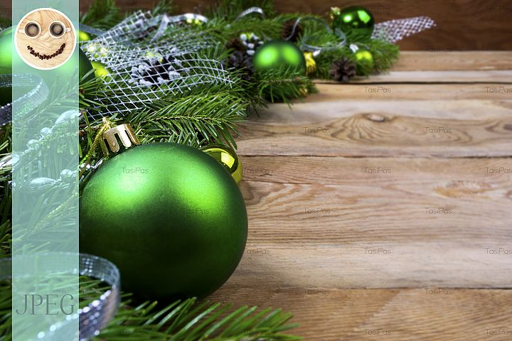 Christmas green baubles on wooden background, copy space
