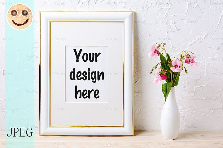 Gold decorated frame mockup with flower bouquet