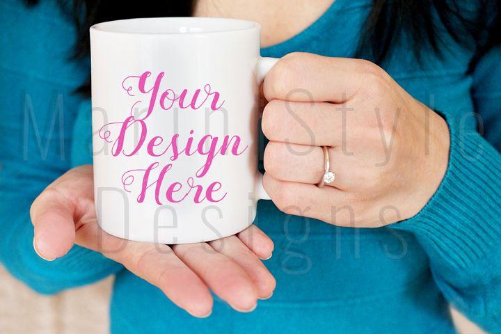 Womans hands holding mug stock image, blue background, 372