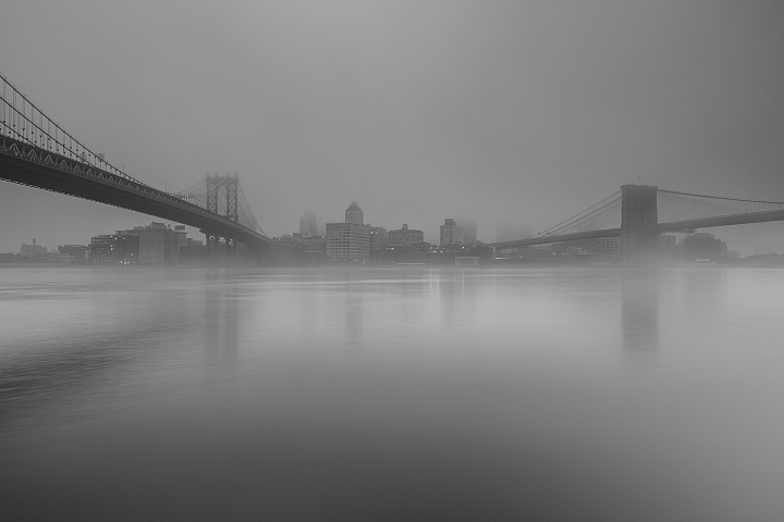 Dumbo view from east river on foggy morning