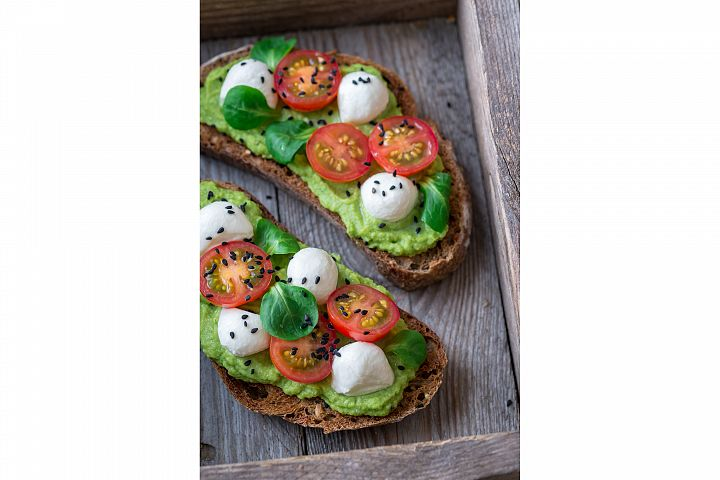 Sandwiches with avocado paste, cherry tomatoes and mozzarell