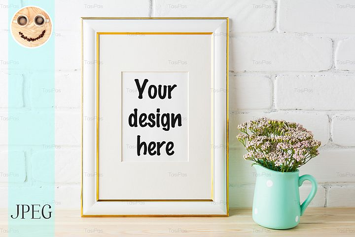 Gold decorated frame mockup with soft pink flowers and brick