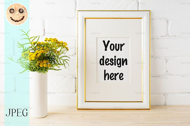 Gold decorated frame mockup yellow flowers near brick walls