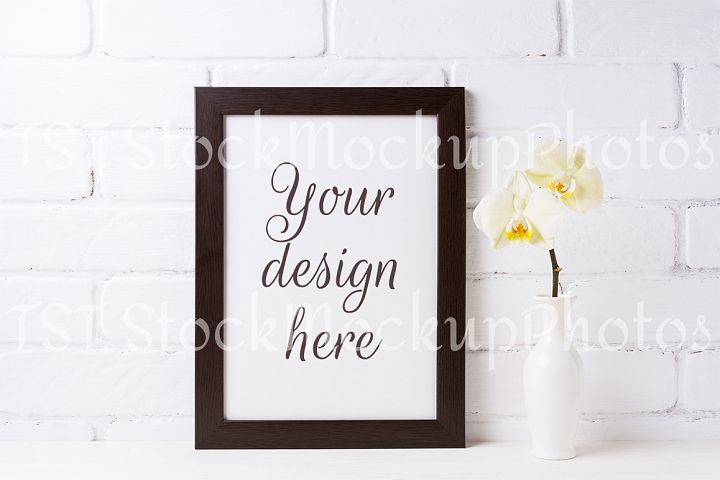 Black brown  frame mockup with soft yellow orchid in vase
