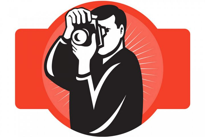 photographer aiming slr camera front