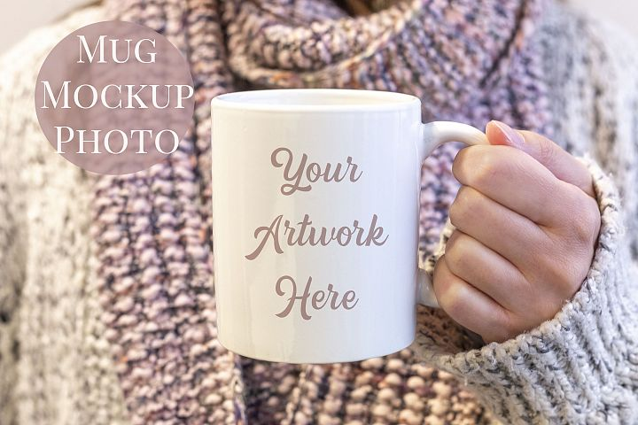 Woman holding a mug, winter jumper