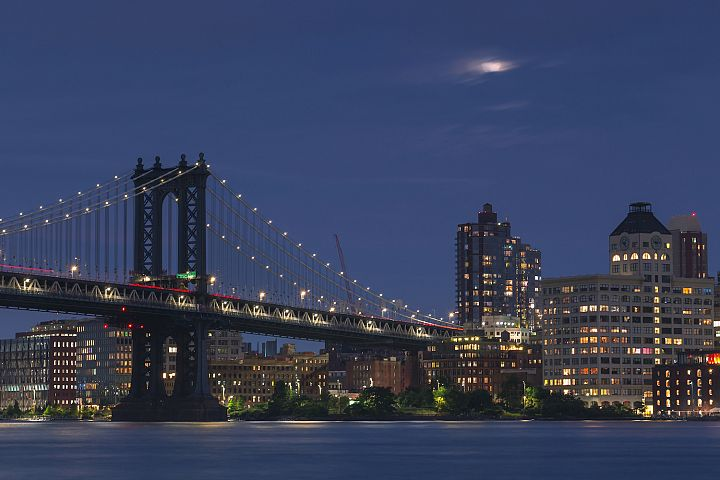 Manhattan Bridge and Dumbo from East River with full moon