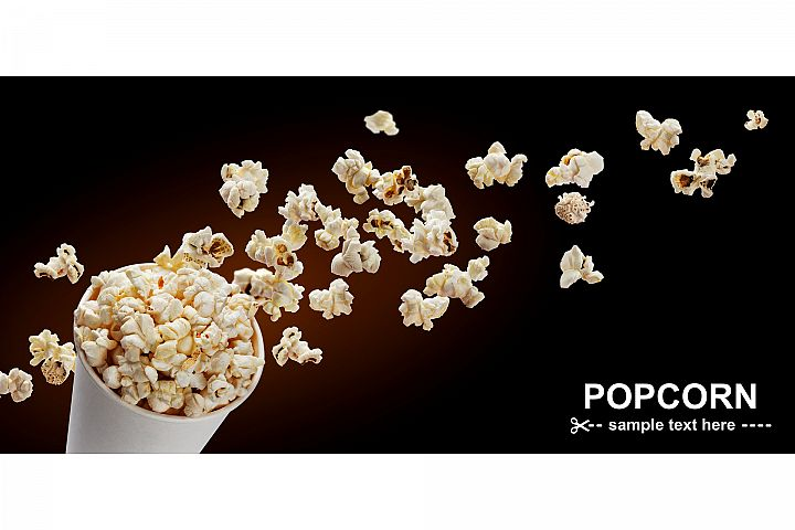 Popcorn in cardboard box isolated on black background