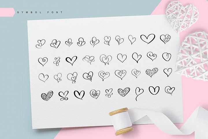 Lovingly Symbol Flourish Hearts Font example image 2