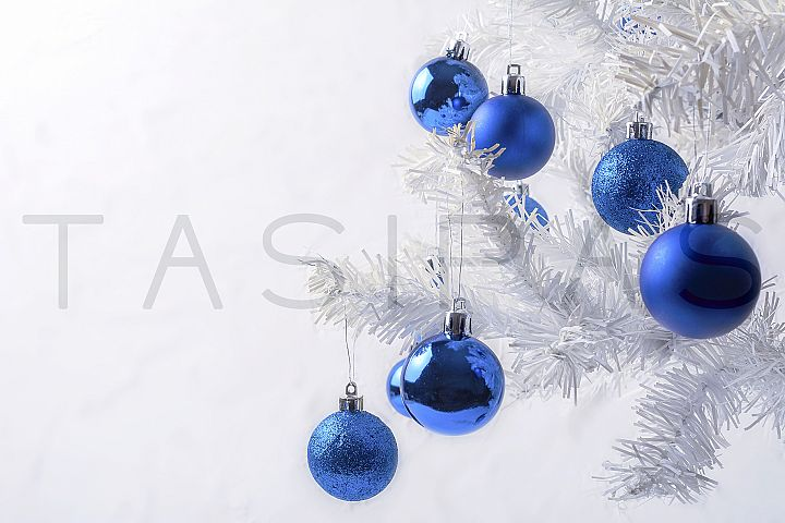 White Christmas tree with blue ornament copy space.