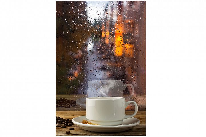 Cup of strong coffee on the rainy window background