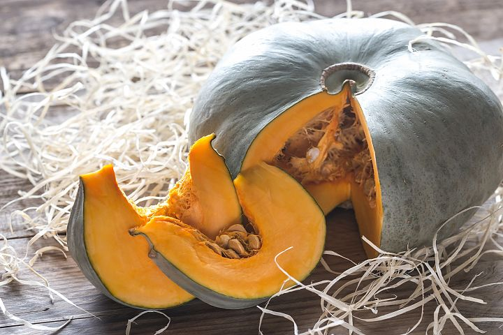 Ripe pumpkin on the wooden background