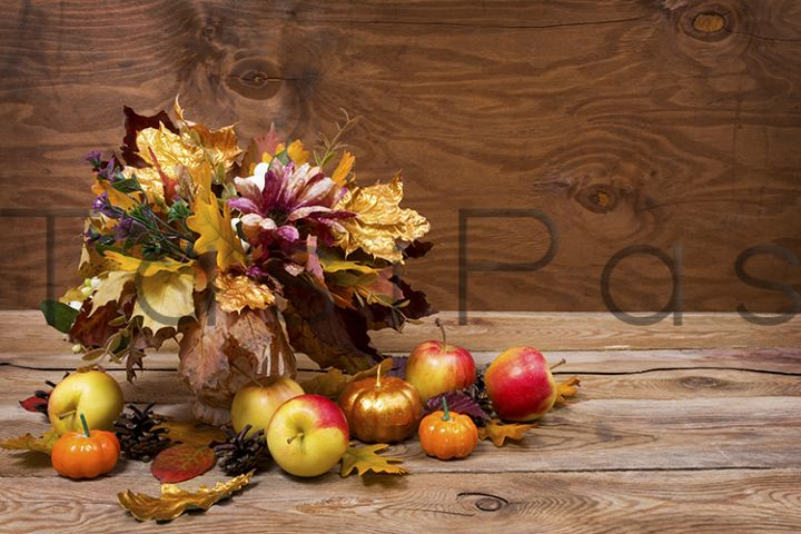 Fall centerpiece with golden leaves, copy space