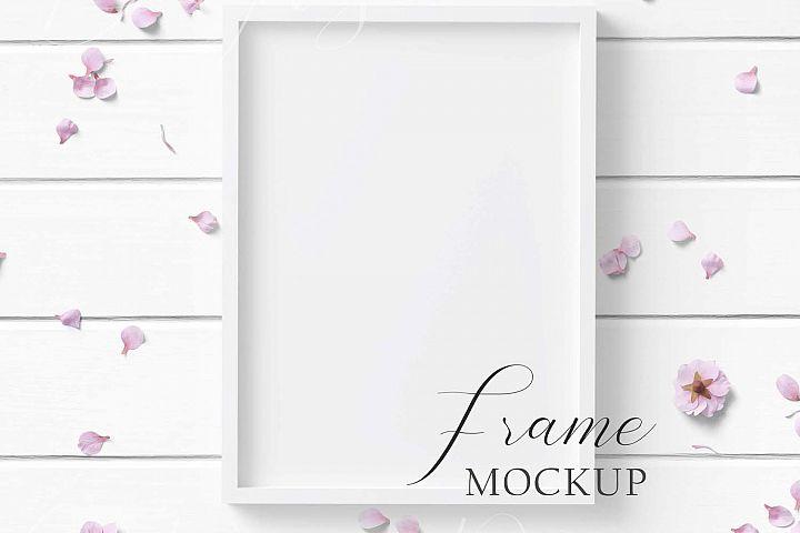 5x7 White Frame Mockup on white wood background.