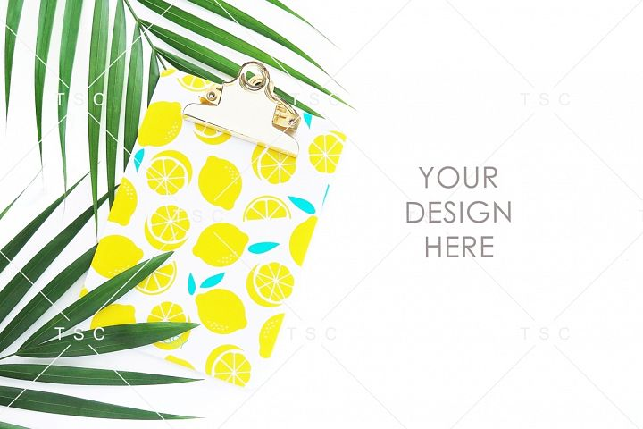 Lemon Paper Clipboard and Palm Leaves Stock Photo