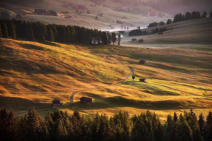 Beautiful sunrise on the meadows in Dolomites