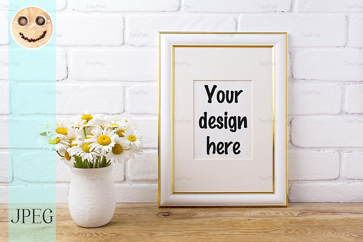 Gold decorated frame mockup with chamomile bouquet in vase