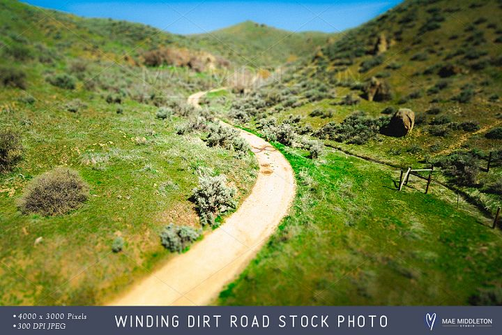 Winding Dirt Road on Hill stock photo