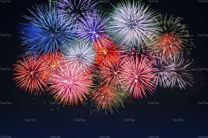 Amazing red, golden, blue fireworks over night sky