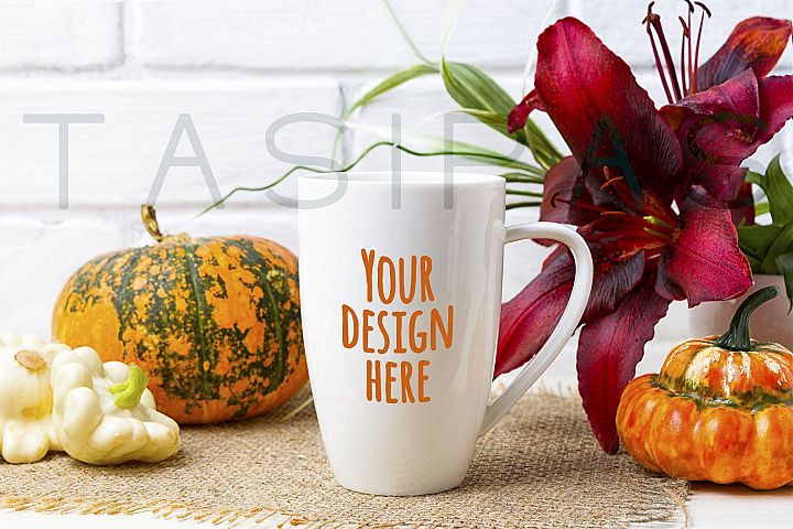White coffee cappuccino mug mockup with pumpkin and red lily