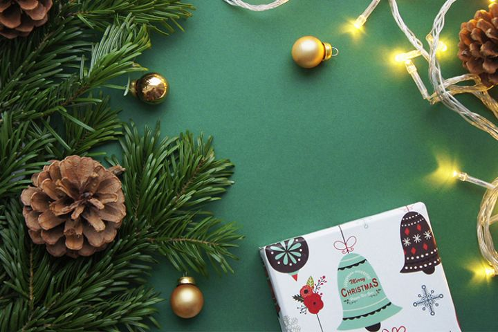 Christmas and New Year background with garland and giftbox