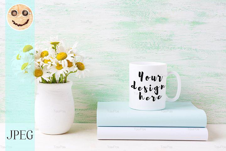 White coffee mug mockup with white field chamomile bouquet