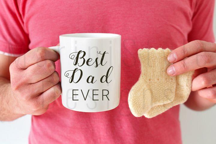 Man holding coffee mug & baby socks, mug mockup, 387