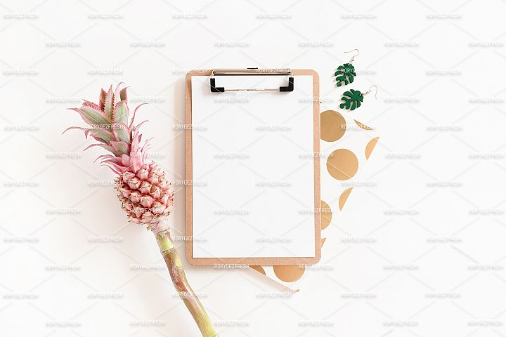 Flatlay of clipboard mockup, notepad, earrings
