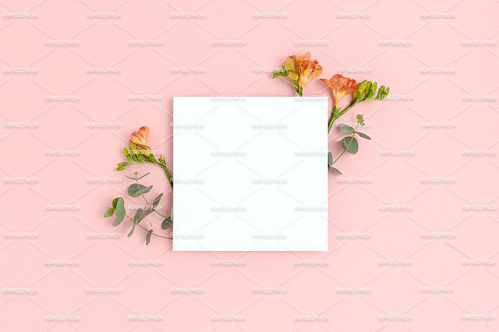 Blank paper card mockup with frame made of flowers